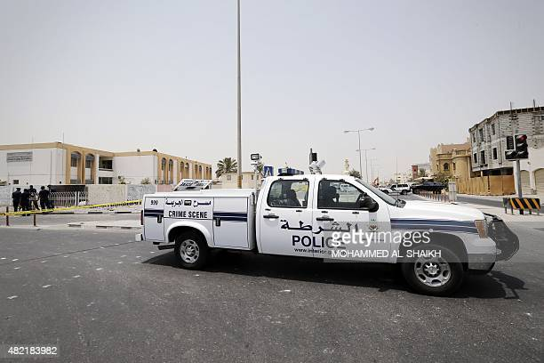 Bahraini forensic police inspect the site of a bomb blast in the village of Sitra south of Manama on July 28 2015 The blast killed two Bahraini...