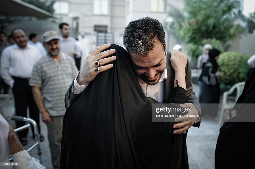 Bahraini former opposition MP Khalil Marzuq (C-R) hugs his mother at his brother's house in the village of Bu Qawah, west of the capital Manama, on October 24, 2013, after he was released from jail. A Bahraini criminal court released the prominent Shiite opposition figure at the opening of his trial for inciting 'terrorist crimes' and set the next hearing for November 18.