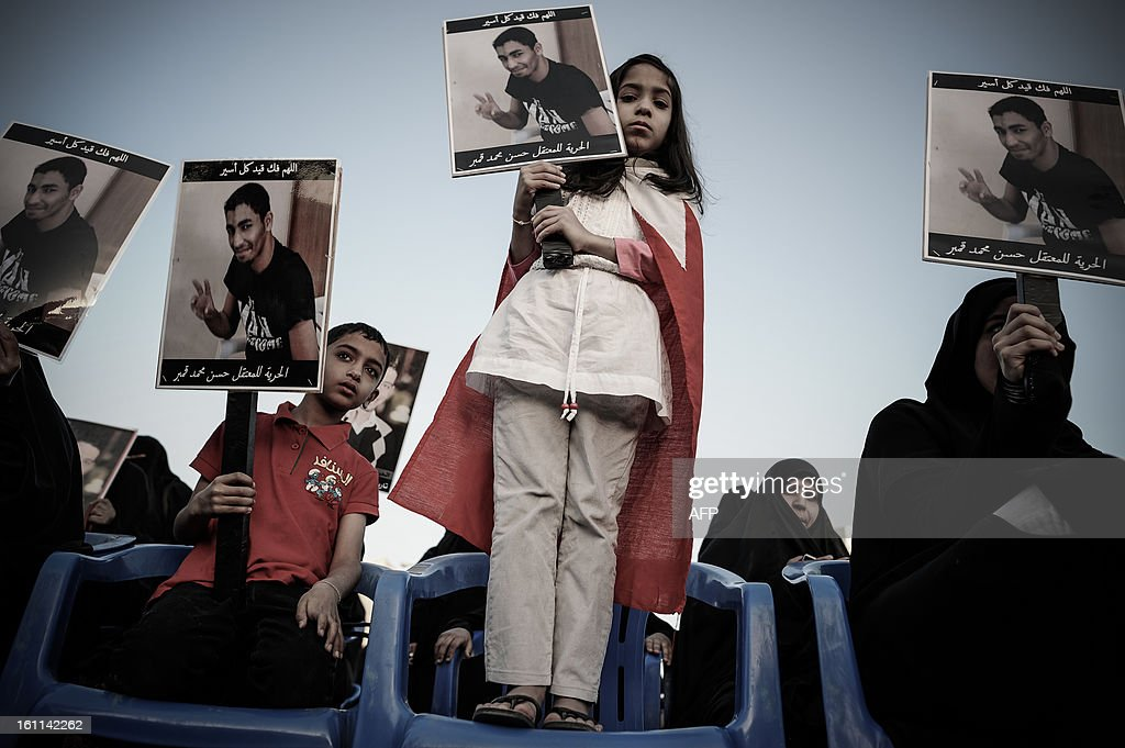 A Bahraini girl holds up a picture of her relative detainee during an anti-government rally to demand reforms on February 9, 2013 in the village of Al Muqsha, west of the Bahraini capital Manama. Bahrain's national dialogue is set to resume on February 10, in an atmosphere of mutual mistrust between government and the opposition ahead of the second anniversary of a Shiite-led uprising that shook the Gulf kingdom.