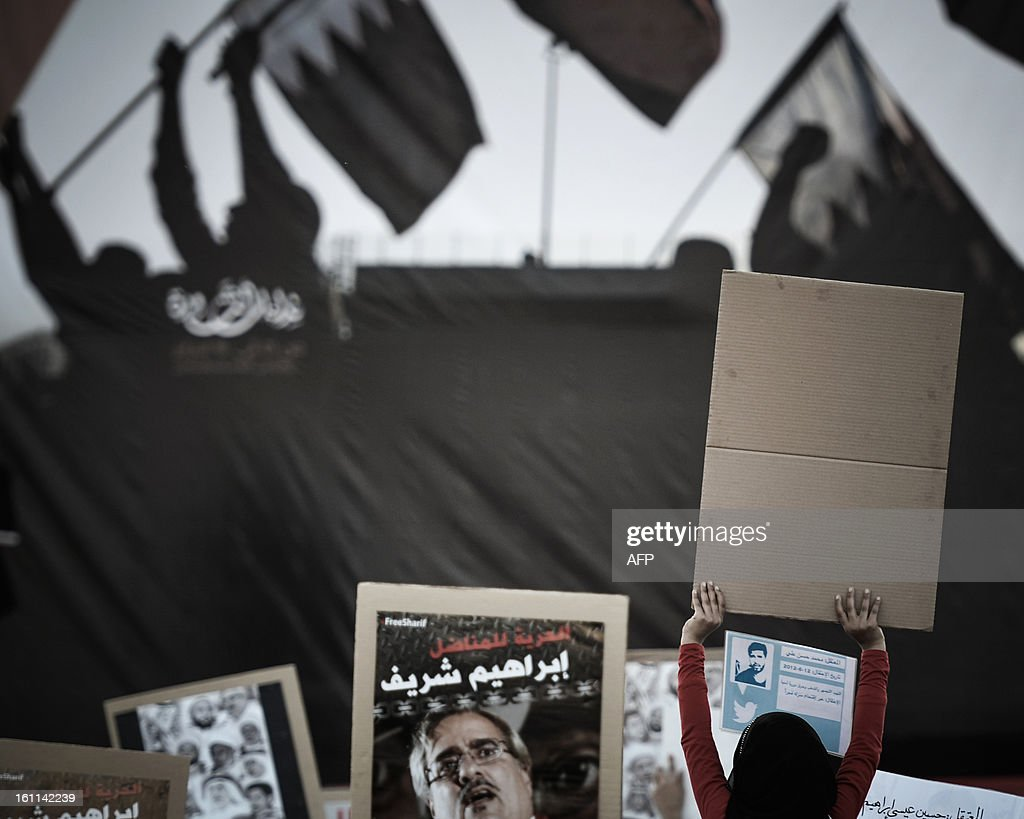A Bahraini girl holds up a placard during an anti-government rally to demand reforms on February 9, 2013, in the village of Al Muqsha, west of the Bahraini capital Manama. Bahrain's national dialogue is set to resume on February 10, in an atmosphere of mutual mistrust between government and the opposition ahead of the second anniversary of a Shiite-led uprising that shook the Gulf kingdom. AFP PHOTO/MOHAMMED AL-SHAIKH