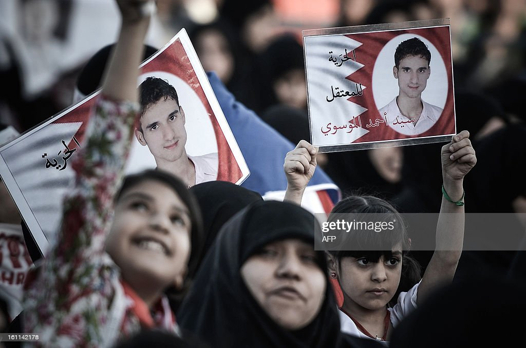 A Bahraini girl holds up picture of her relative detainee during an anti-government rally to demand reforms on February 9, 2013 in the village of Al Muqsha, west of the Bahraini capital Manama. Bahrain's national dialogue is set to resume on February 10, in an atmosphere of mutual mistrust between government and the opposition ahead of the second anniversary of a Shiite-led uprising that shook the Gulf kingdom.