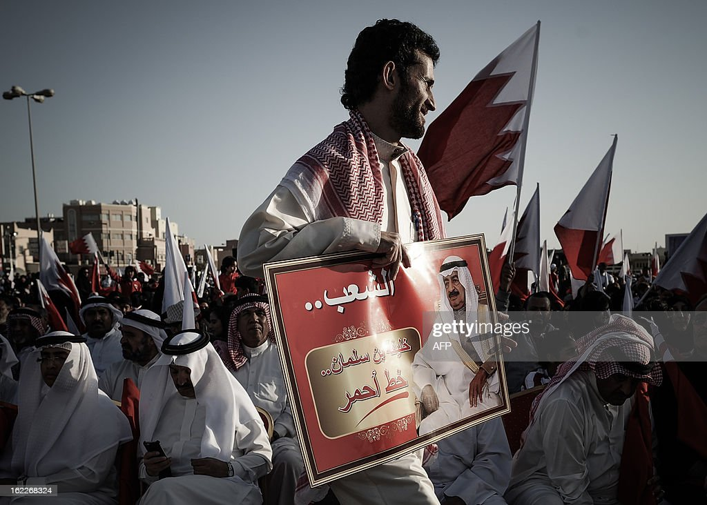 A Bahraini holds a placard featuring Prime Minister Sheikh Khalifa bin Salman Al-Khalifa during a pro-government rally in the village of Arad on the Bahraini island of Muharraq on February 21, 2013.