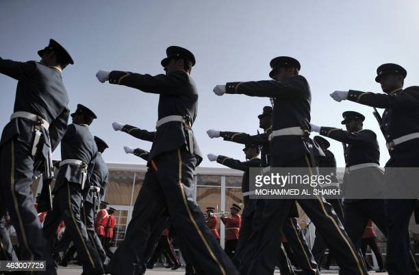 Bahraini Honor Guard parade as they prepare for the opening of the Bahrain International Airshow 2014 in Sakhir south of the capital Manama on...