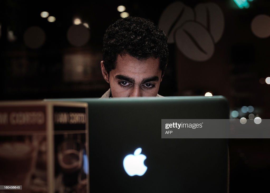 A Bahraini man browses the internet on his laptop in a coffee shop in the capital Manama on January 29, 2013. Twitter's unmatched platform for public opinion is emboldening Gulf Arabs to exchange views on delicate issues in the deeply conservative region, despite strict censorship that controls old media.