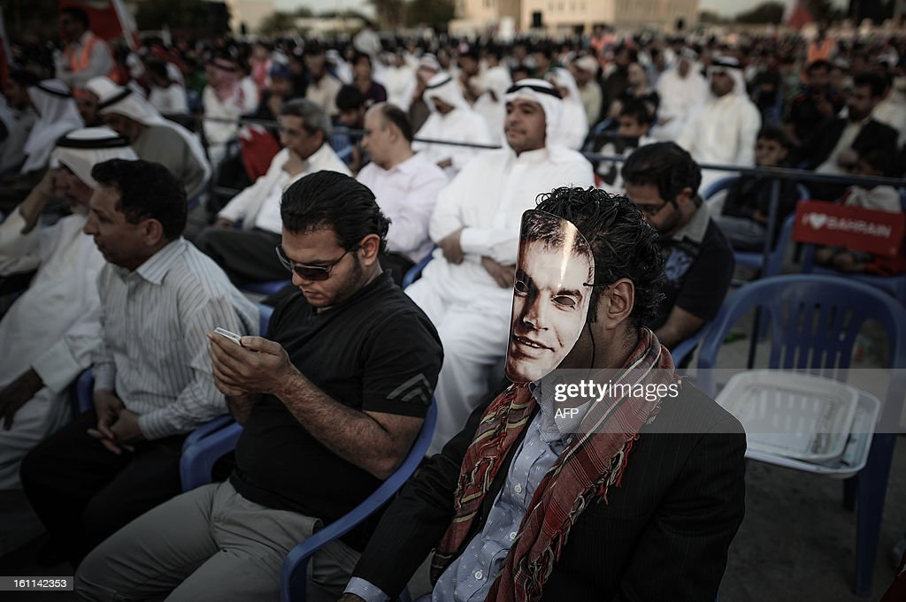 A Bahraini man covers his face with a mask picturing the face of human rights activist Nabil Rajab, during an anti-government rally to demand reforms on February 9, 2013 in the village of Al Muqsha, west of the Bahraini capital Manama. Bahrain's national dialogue is set to resume on February 10, in an atmosphere of mutual mistrust between government and the opposition ahead of the second anniversary of a Shiite-led uprising that shook the Gulf kingdom. AFP PHOTO/MOHAMMED AL-SHAIKH