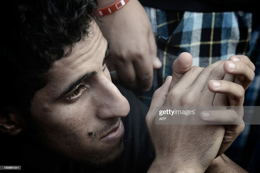 A Bahraini man looks on during the funeral of 16-year-old Ali Abbas Radhi in the village of Samahij, Muharraq City, east of capital Manama on November 10, 2012. The Shiite Muslim teenager died after he was knocked down by a car while being chased by Bahraini police during a crackdown on protesters, the opposition said. AFP PHOTO/MOHAMMED AL-SHAIKH