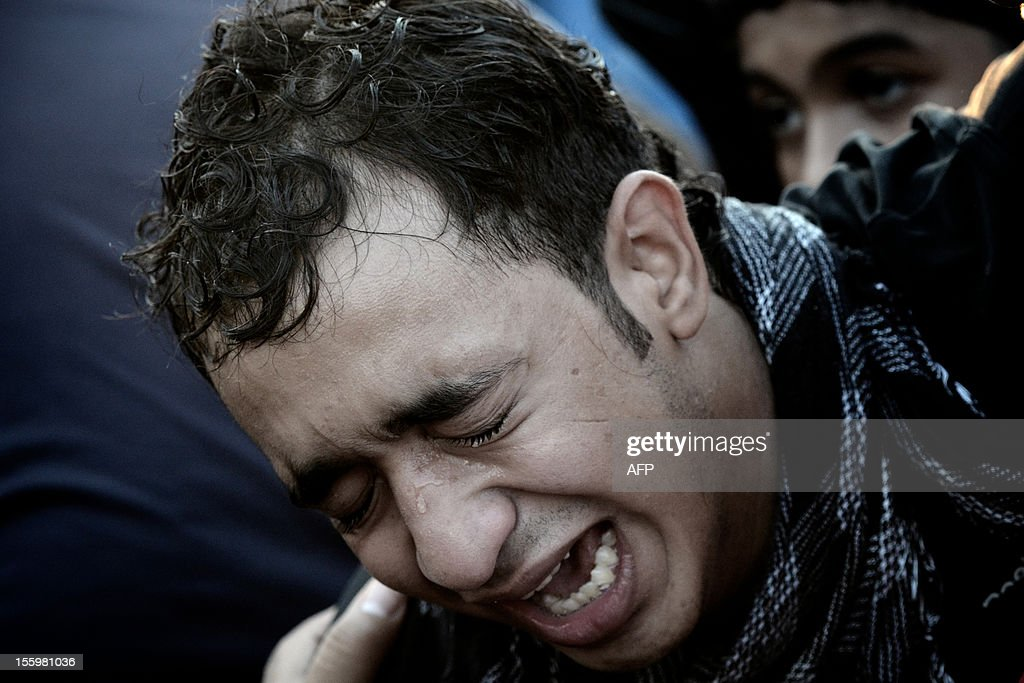 A Bahraini man mourns during the funeral of 16-year-old Ali Abbas Radhi in the village of Samahij, Muharraq City, east of capital Manama on November 10, 2012. The Shiite Muslim teenager died after he was knocked down by a car while being chased by Bahraini police during a crackdown on protesters, the opposition said. AFP PHOTO/MOHAMMED AL-SHAIKH