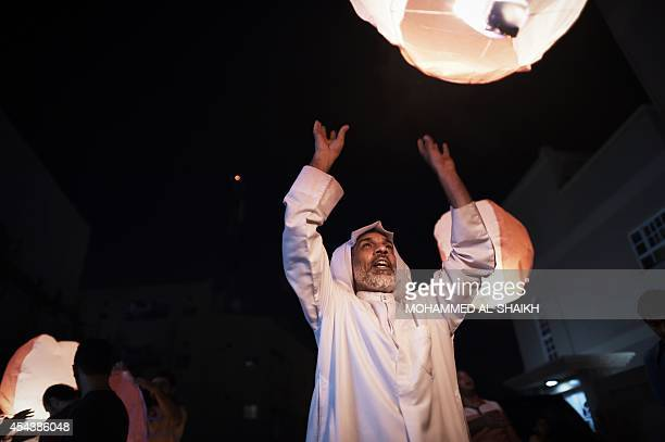 A Bahraini man releases a lantern during a protest in solidarity with jailed Bahraini photographer Ahmed Humaidan in the village of Sitra south of...