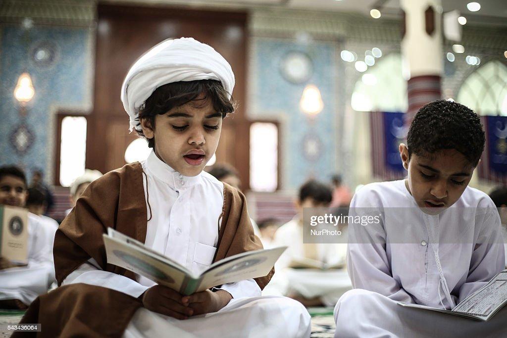 Bahraini Muslim children read the holy Quran while observing Qadr night in Ramadan, in Manama, Bahrain, on June 28, 2016.