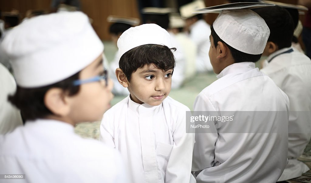 Bahraini Muslim children read the holy Quran while observing Qadr night in Ramadan, in Manama, Bahrain, on June 28, 2016.