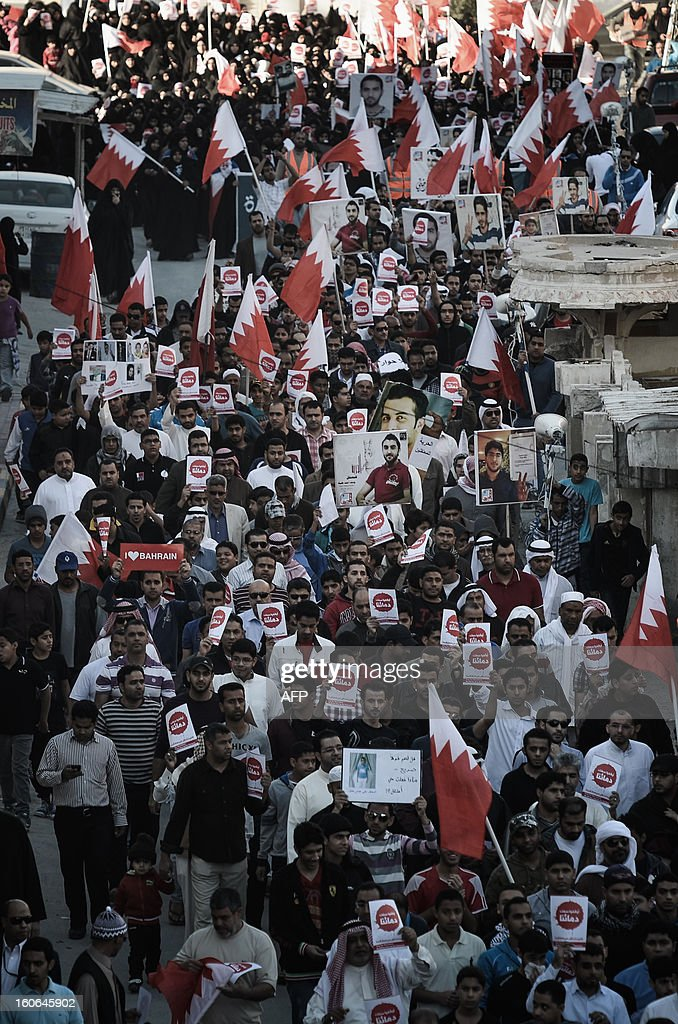 Bahraini people wave national flags during an anti-government rally to demand reforms on February 4, 2013 in the city of Muharraq, east of the Bahraini capital Manama. Bahrain's justice ministry announced that national talks aimed to end the kingdom's political stalemate will resume on February 10, 2013 after an earlier round failed to bring the opposition onboard.