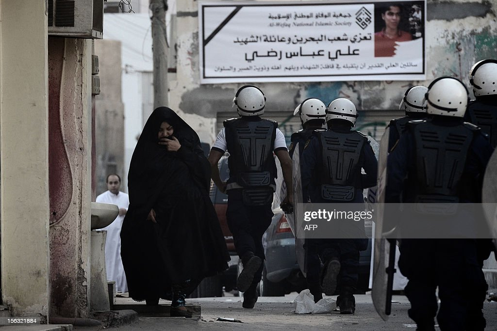 Bahraini police force try to disperse protestors during clashes following an anti-government demonstration on the third day after the funeral of 16-year-old Ali Abbas Radhi in the village of Samahij, east of the capital Manama, on November 13, 2012. The Shiite teenager died on November 9, after he was knocked down by a car while being chased by Bahraini police during a crackdown on protesters, the opposition said.