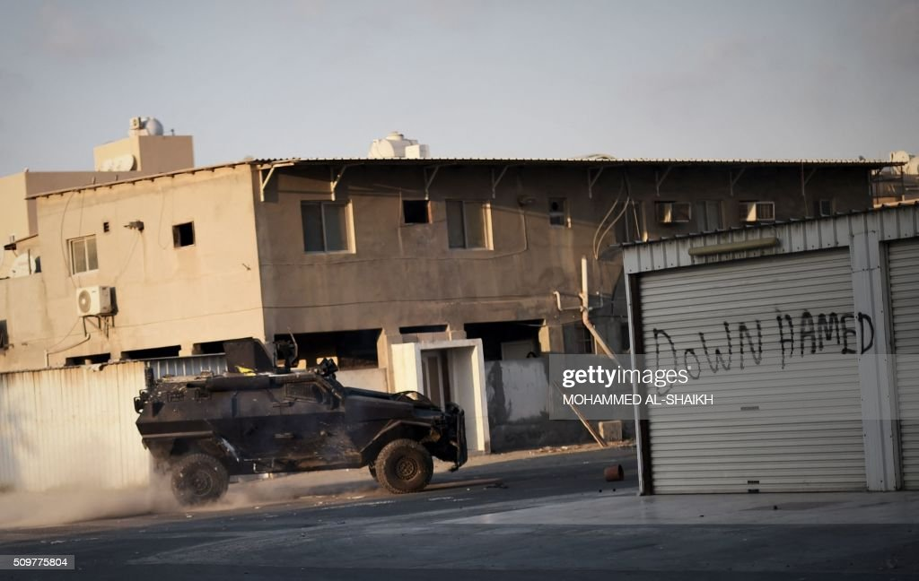 A Bahraini police vehicle patrols a street during clashes with protesters following a demonstration to mark the fifth anniversary of the Arab Spring-inspired uprising, on February 12, 2015, in the mainly Shiite village of Sitra, south of Manama. Five years after Sunni-ruled Bahrain crushed a popular uprising by the Shiite majority, the kingdom is locked in a political impasse exacerbated by an economic crisis, analysts say. / AFP / MOHAMMED AL-SHAIKH
