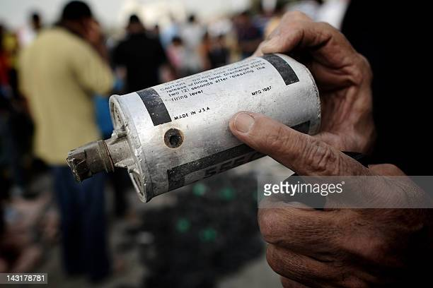 A Bahraini protester shows an American manufactured teargas canister that was fired by riot police during a demonstration in a Shiite suburb of the...