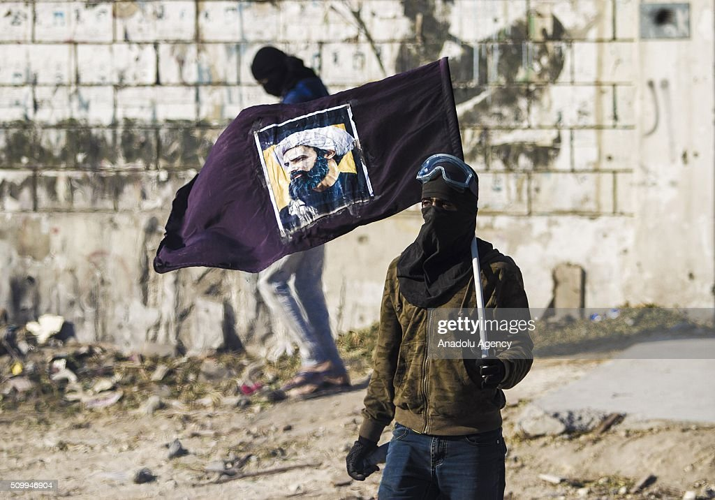 Bahraini protesters are seen during clashes with security forces following a demonstration to mark 5th Bahrain uprising anniversary in Manama, Bahrain on February 13, 2016.