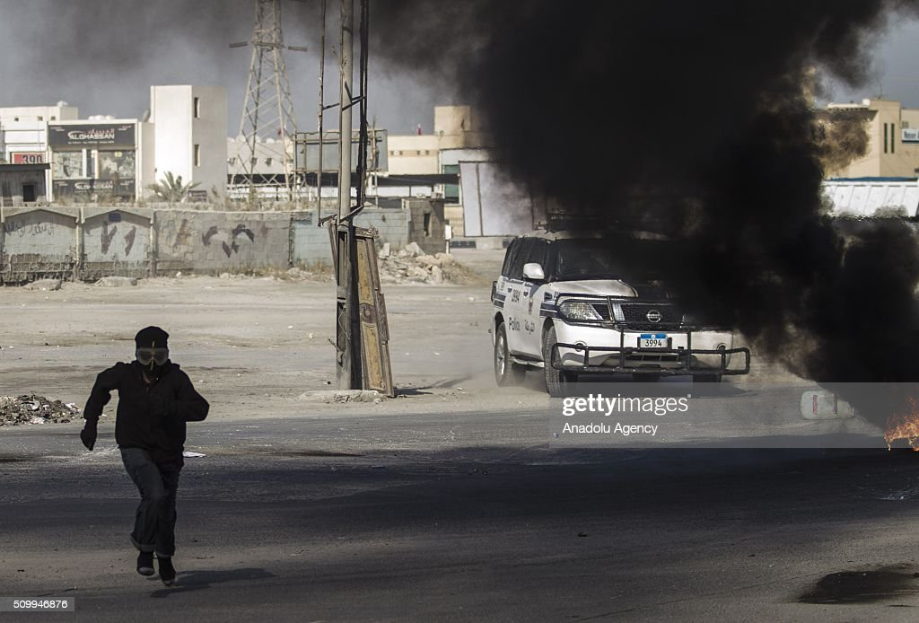 Bahraini protesters run from security forces during clashes with security forces following a demonstration to mark 5th Bahrain uprising anniversary in Manama, Bahrain on February 13, 2016.