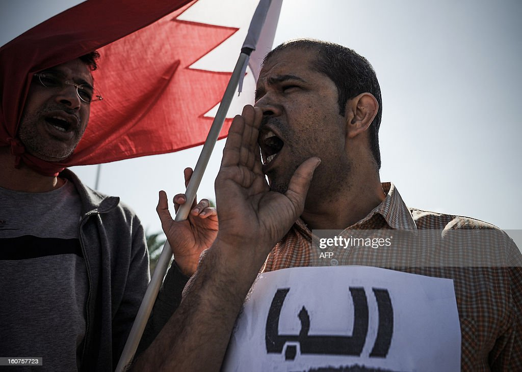 Bahraini protesters shout slogans during a demonstration, organised by people who were dismissed from their jobs because they attended anti-regime protests, outside the labour ministry in Isa, south of the capital Manama, on February 5, 2013. Many Shiite employees were either dismissed or indefinitely suspended from their jobs in the wake of a brutal crackdown on Shiite-led Arab Spring-inspired protests in March 2011.