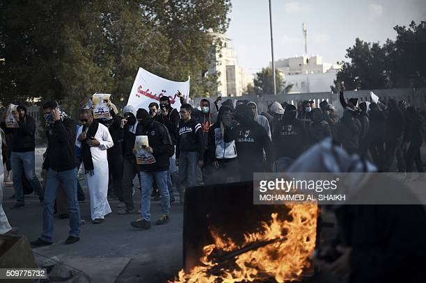 Bahraini protesters take part in a demonstration to mark the fifth anniversary of the Arab Springinspired uprising on February 12 in the mainly...