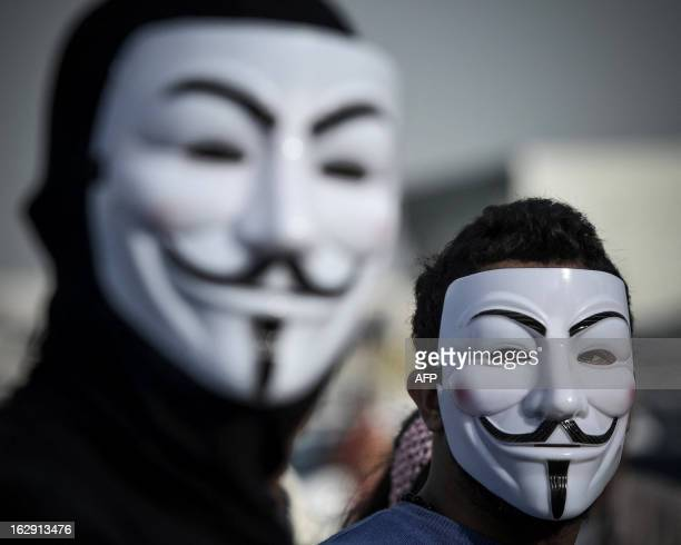 Bahraini protesters wearing Guy Fawkes masks used by the Anonymous movement take part in a demonstration against the government and in solidarity...