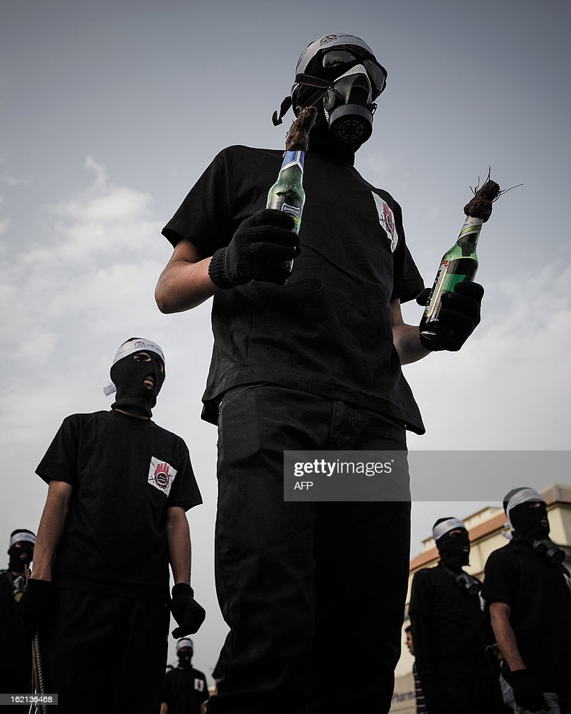 A Bahraini protestor holds petrol bombs during clashes with riot police following an anti-government protest against the death of a teenager Hussein al-Jazeeri (Jazizi) in the village of Daih, west of Manama, on February 19, 2013. The 16-year-old was killed in Daih on February 14, during protests marking the second anniversary of the Shiite Muslim-led uprising.