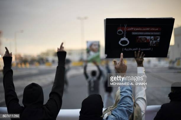 Bahraini protestors hold up placards depicting portraits of Sheikh Ali Salman head of the Shiite opposition movement alWefaq during clashes with riot...