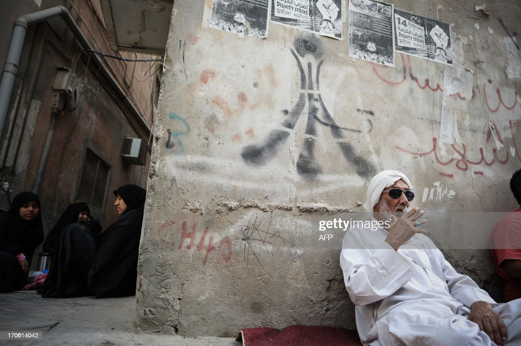Bahraini protestors sitting outside their homes waiting for the protest in the village of Bilad al-Qadeem, in a suburb of Manama, on June 15, 2013.