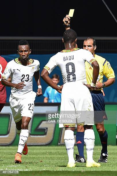 Bahraini referee Nawaf Abdulla Ghayyath Shukralla give Ghana's defender Harrison Afful a yellow card during the Group G football match between...