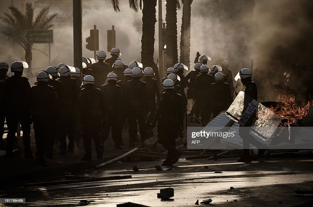 Bahraini riot police move forward to disperse protesters during clashes following the funeral of a teenager killed in protests marking the second anniversary of a Shiite-led uprising, on February 16, 2013 in the village of Daih, west of Manama. Clashes broke out at the funeral with police using tear gas against mourners, witnesses said.