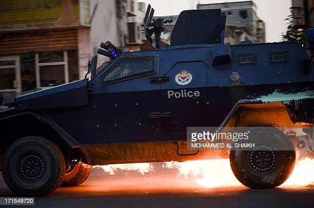 A Bahraini riotpolice car is hit by a petrol bomb during clashes with demonstrators following the funeral of Hussein Abdullah in the village of Saar...