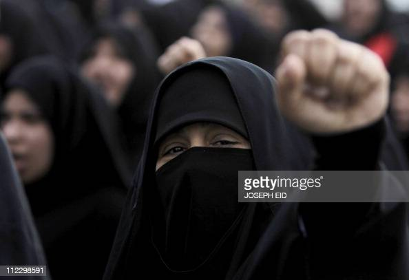 A Bahraini Shiite antigovernment protester chants slogans against the regime during a march from Pearl Square to Manama's old city on February 24...