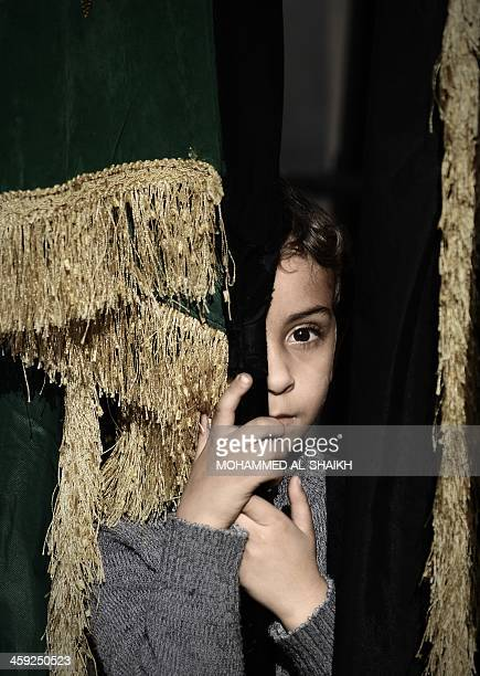 A Bahraini Shiite Muslim boy takes part in the Arbaeen religious festival which marks the 40th day after Ashura commemorating the seventh century...