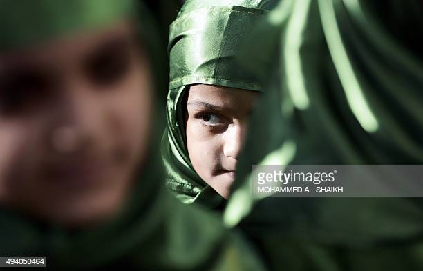 Bahraini Shiite Muslim girls take part in a ceremony marking Ashura which commemorates the seventh century slaying of Imam Hussein the grandson of...