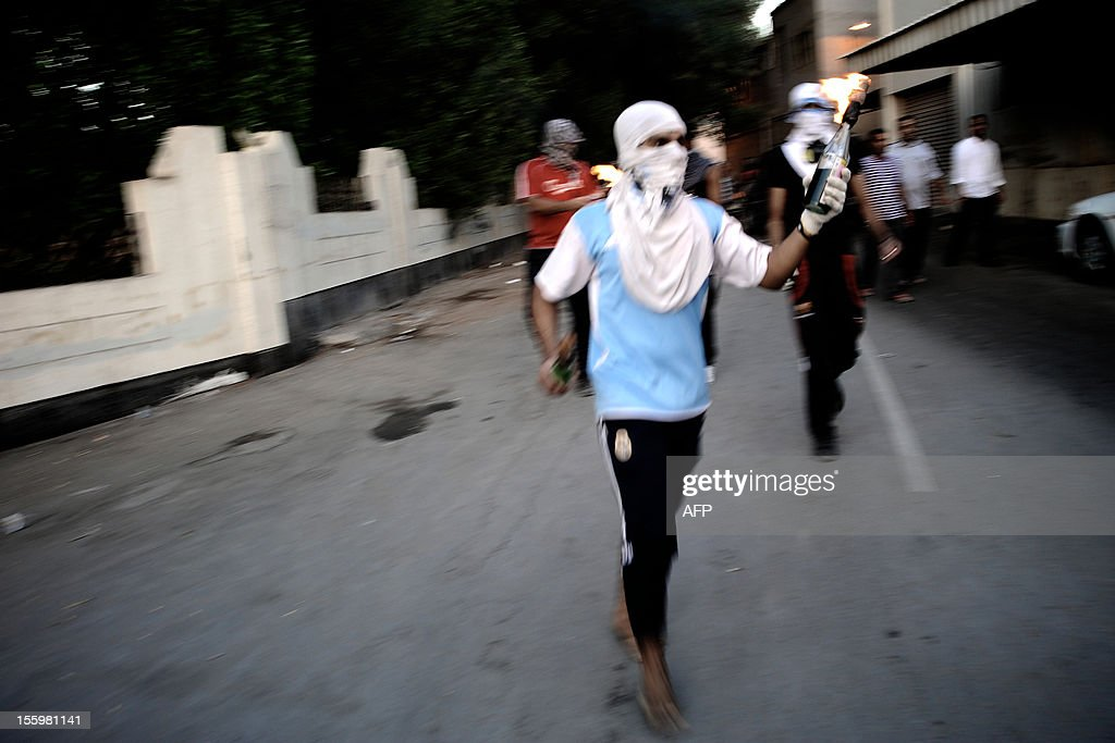A Bahraini Shiite Muslim protestor prepares to throw a petrol bomb at riot police who responded by firing bird shots and tear gas during clashes following the funeral of 16-year-old Ali Abbas Radhi in the village of Samahij, Muharraq City, east of capital Manama on November 10, 2012. The Shiite Muslim teenager died after he was knocked down by a car while being chased by Bahraini police during a crackdown on protesters, the opposition said.