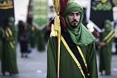 A Bahraini Shiite Muslim takes part in a ceremony marking Ashura which commemorates the seventh century slaying of Imam Hussein the grandson of...