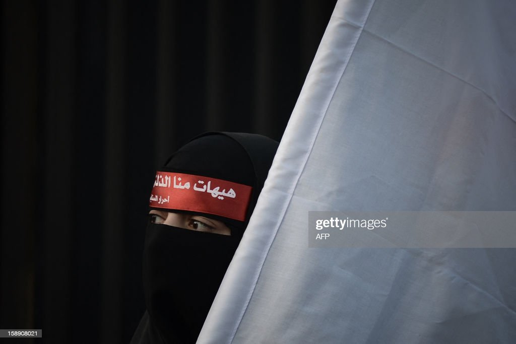 A Bahraini Shiite Muslim woman attends the Arbaeen religious festival in the village of Sanabis, west of Manama, on January 3, 2013, to mark the 40th day after Ashura, commemorating the seventh century killing of Prophet Mohammed's grandson, Imam Hussein.