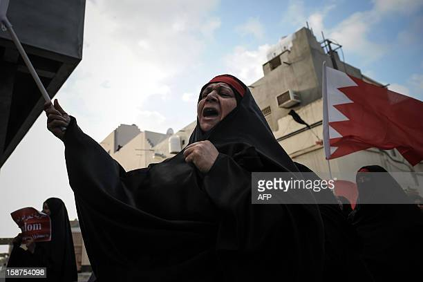 A Bahraini Shiite Muslim woman shouts slogans during an antigovernment protest in solidarity with jailed Bahraini women in the village of Mahaza in...