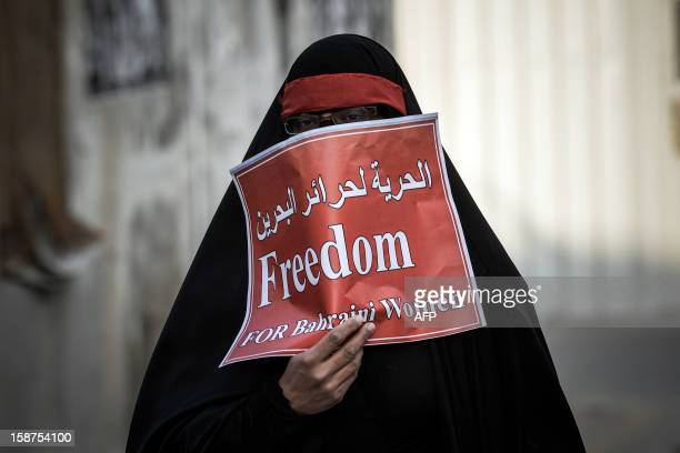 A Bahraini Shiite Muslim woman takes part in an antigovernment protest in solidarity with jailed Bahraini women in the village of Mahaza in Sitra...