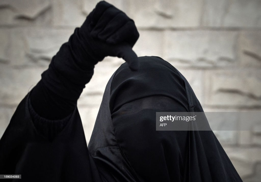 A Bahraini Shiite Muslim woman wearing the niqab shouts antigovernment slogans during a demonstration in solidarity with human rights activists and...