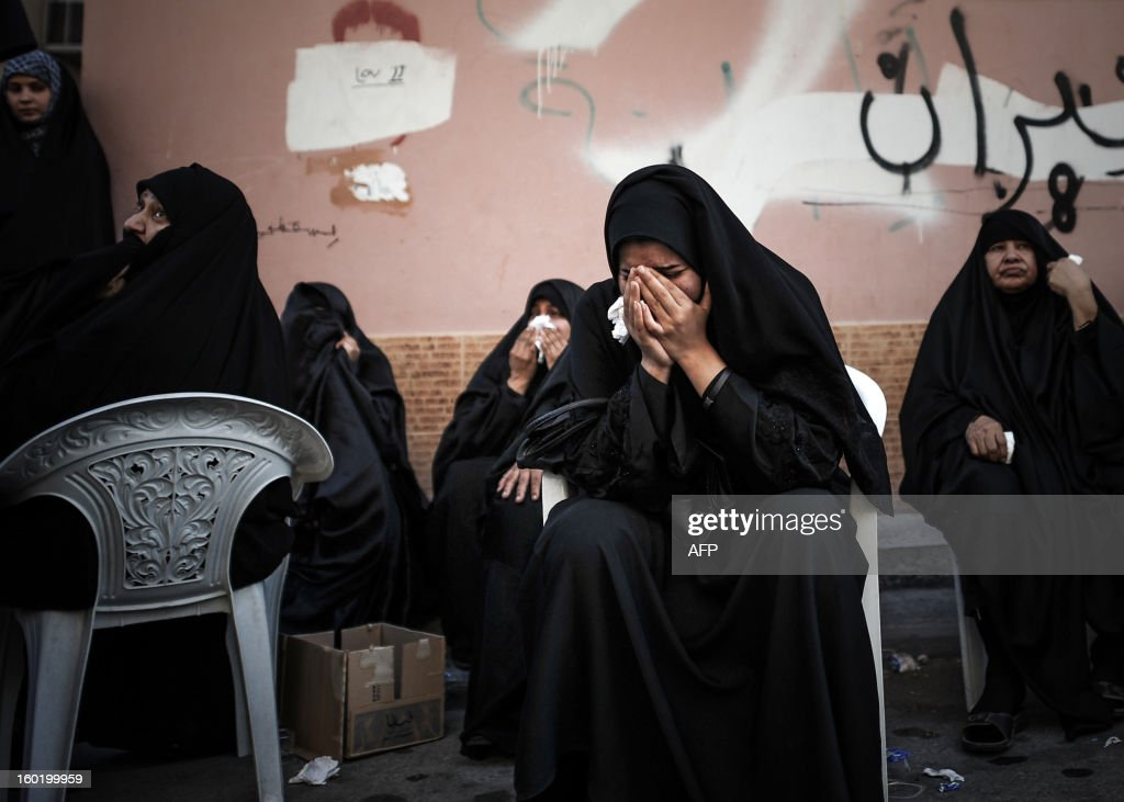 Bahraini Shiite Muslim women mourn during the funeral of a eight-year-old child, Qassim Habib Marzooq on January 27, 2013 in the village of Daih, west of Manama. Marzooq, died at hospital after developing respiratory complications and his relatives claim that his death is due to the inhalation of poisonous tear gas that riot police used during a protest in January 2013.