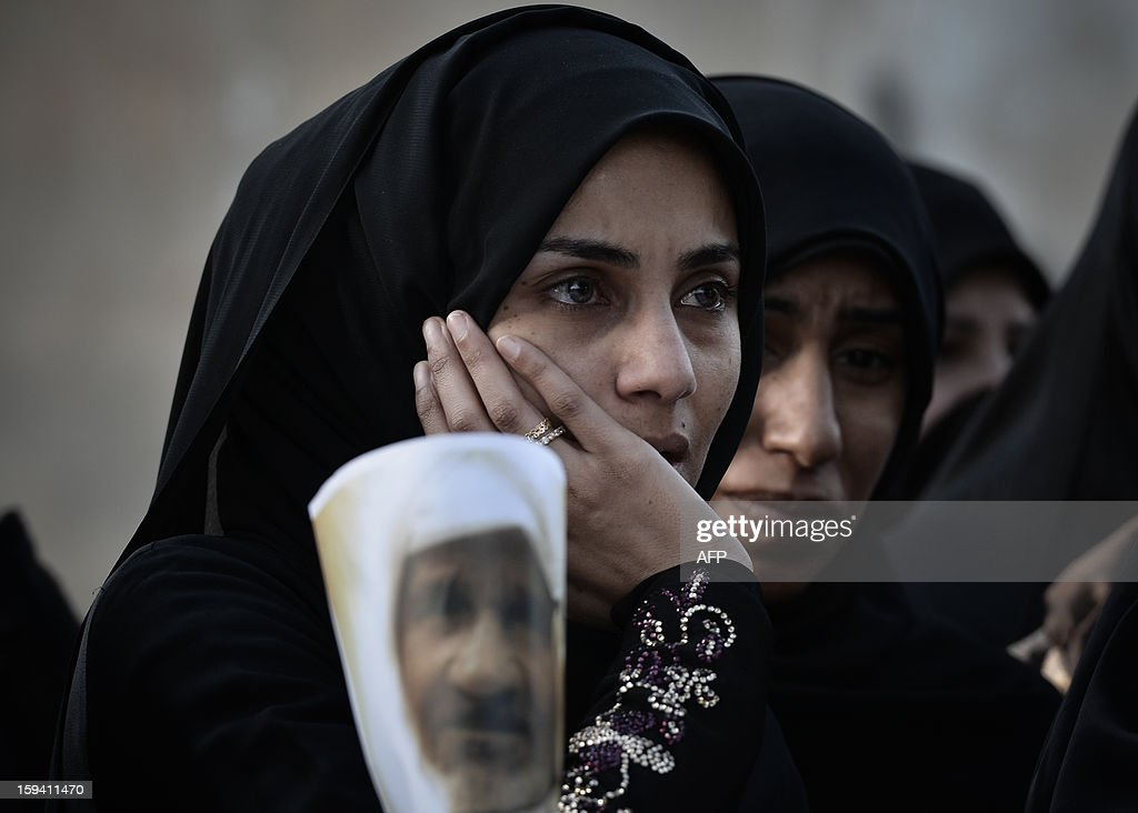 Bahraini Shiite Muslim women mourn during the funeral of Habib Ebrahim Abdullah on January 13, 2013 in the village of Malikiyah, south of Manama. Abdullah, 88, died at hospital after developing respiratory complications and his relatives claim that his death is due to the inhalation of poisonous tear gas that riot police used during a protest in October 2012.