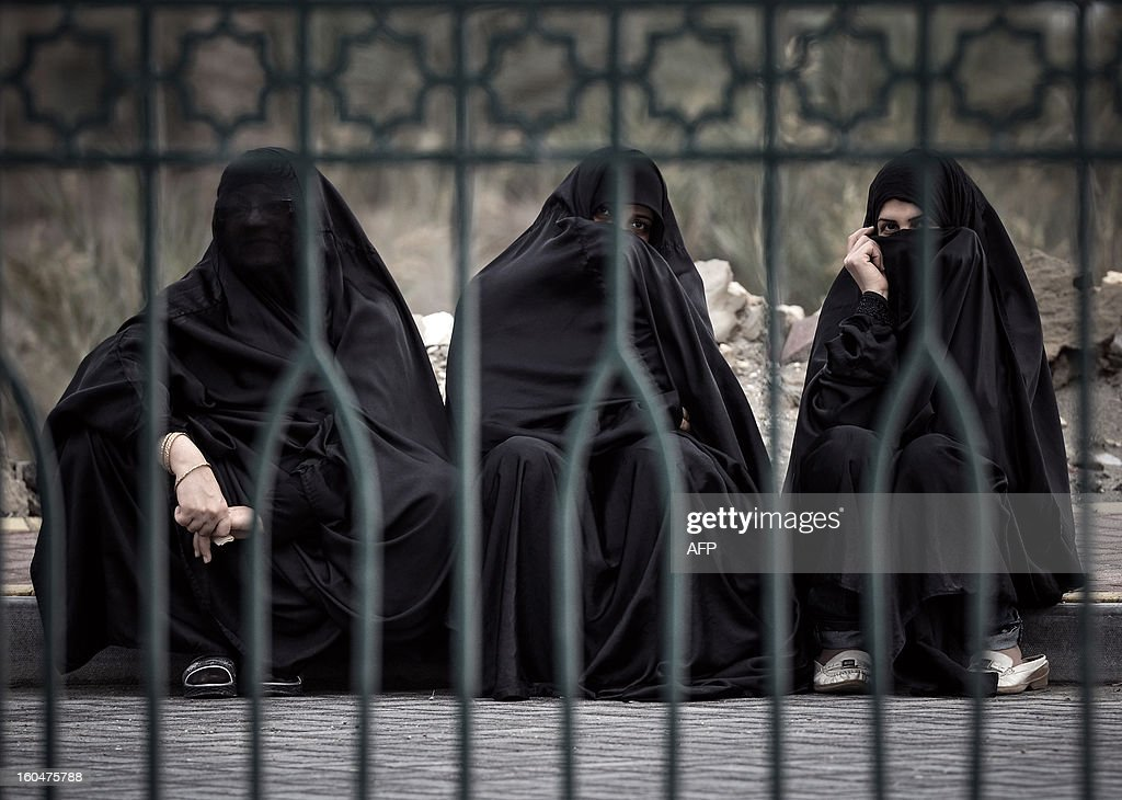 Bahraini Shiite Muslim women sit on a sidewalk during an anti-government demonstration in the village of South Sehla, south of Manama, on February 1, 2013. The Gulf state has been shaken by unrest since its forces in March 2011 crushed a month of popular Shiite-led protests demanding greater rights and an end to what they said was discrimination by the Sunni royals.