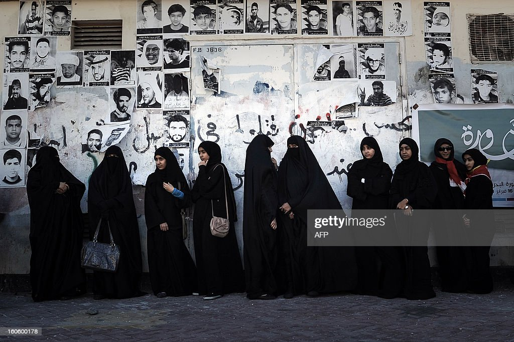 Bahraini Shiite Muslim women, some of whom are wearing the niqab, stand watching an anti-government rally to demand reforms in the village of Malikiya, South of Manama, on February 3, 2013, . The Gulf state has been shaken by unrest since its forces in March 2011 crushed a month of popular Shiite-led protests demanding greater rights and an end to what they said was discrimination by the Sunni royals.