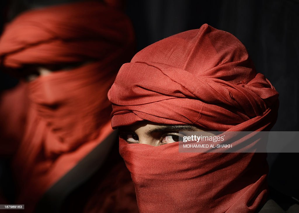 Bahraini Shiite Muslims take part in a ceremony marking Ashura, which commemorates the seventh century slaying of Imam Hussein, the grandson of Prophet Mohammed, on November 14, 2013 in the village of Sanabis, west of the capital Manama. AFP PHOTO/MOHAMMED AL-SHAIKH