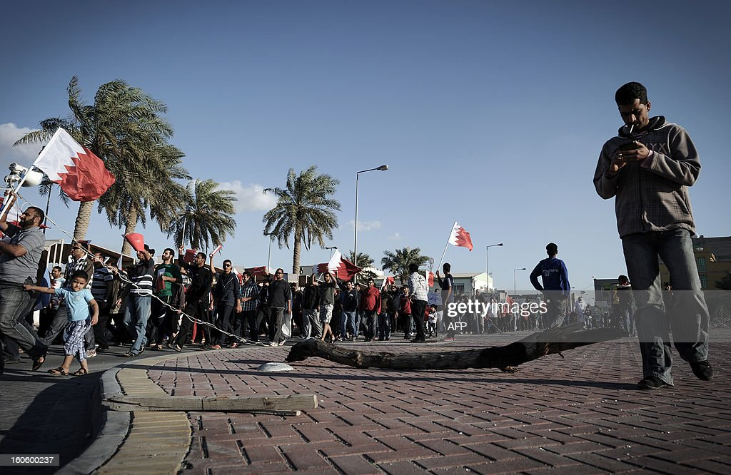 Bahraini Shiite Muslims wave their national flag as they take part in an anti-government rally to demand reforms in the village of Malikiya, South of Manama, on February 3, 2013. The Gulf state has been shaken by unrest since its forces in March 2011 crushed a month of popular Shiite-led protests demanding greater rights and an end to what they said was discrimination by the Sunni royals.