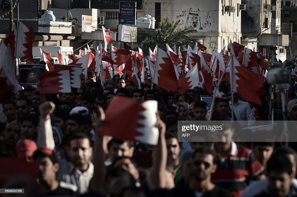 Bahraini Shiite Muslims wave their national flag during an anti-government rally to demand reforms in the village of Malikiya, South of Manama, on February 3, 2013. The Gulf state has been shaken by unrest since its forces in March 2011 crushed a month of popular Shiite-led protests demanding greater rights and an end to what they said was discrimination by the Sunni royals. AFP PHOTO/MOHAMMED AL-SHAIKH