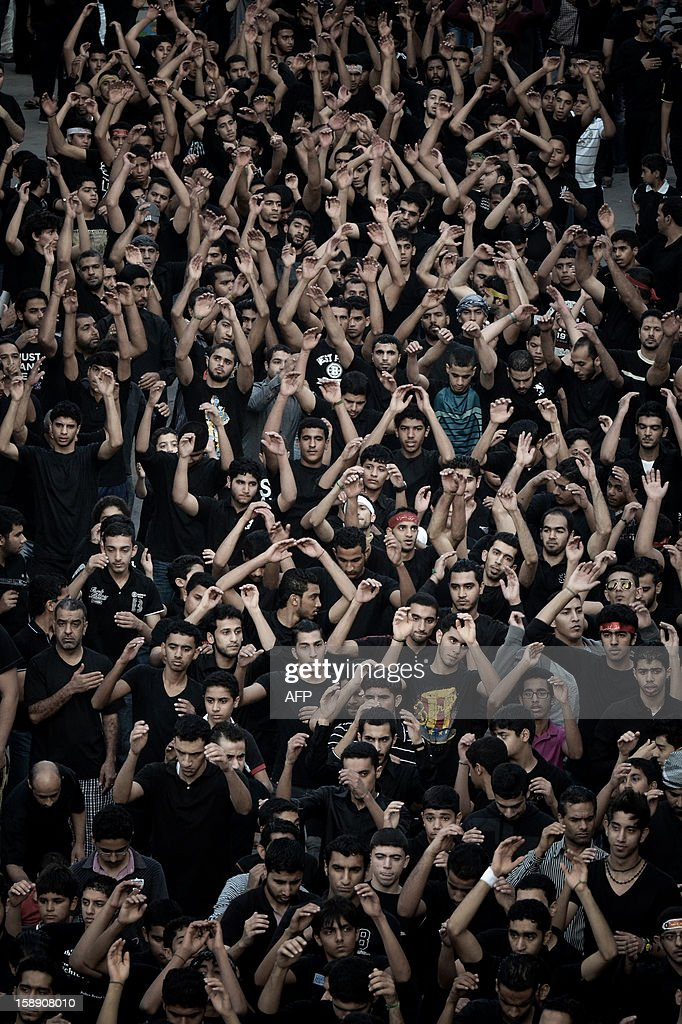 Bahraini Shiite Muslimstake part in the Arbaeen religious festival in the village of Sanabis, west of Manama, on January 3, 2013, to mark the 40th day after Ashura, commemorating the seventh century killing of Prophet Mohammed's grandson, Imam Hussein. AFP PHOTO/MOHAMMED AL-SHAIKH