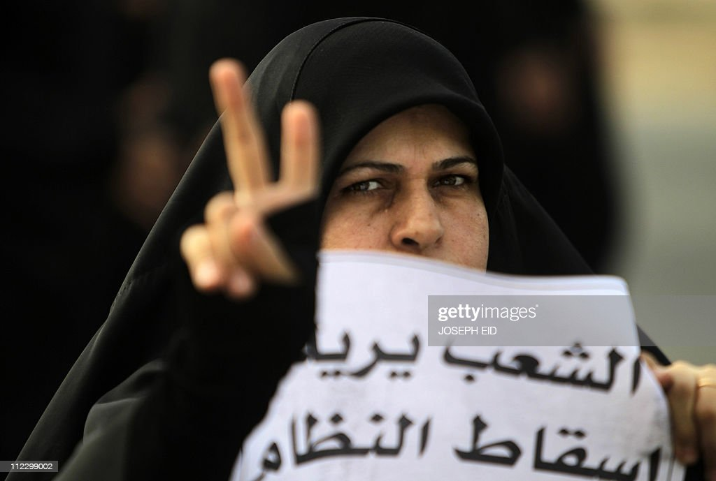 A Bahraini Shiite protester flashes the V sign for 'victory' during a demonstration on February 26 2011 in Manama demanding the Sunni ruling regime...