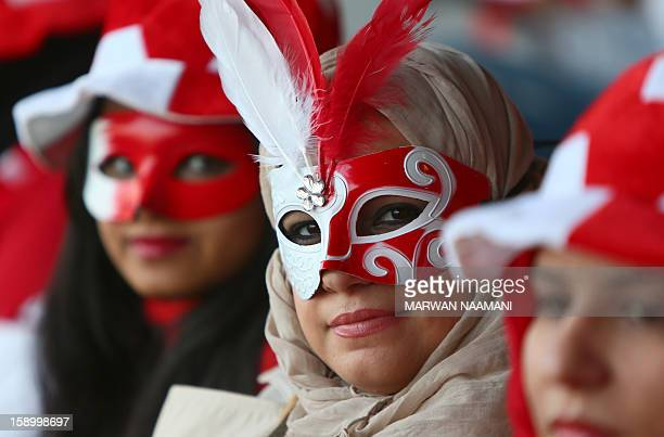 A Bahraini supporter wears a mask prior the sart of the opening ceremony and football match between Bahrain and Oman in the 21st Gulf Cup tournament...