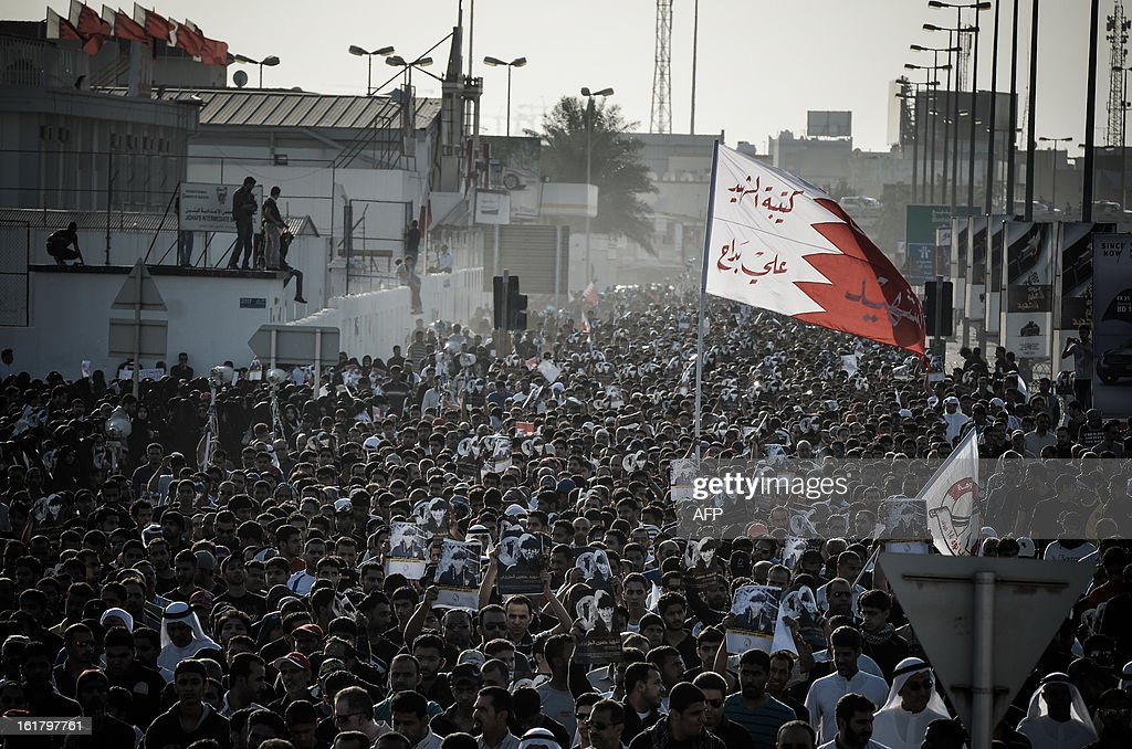 Bahraini take part in the funeral of Hussain Ali Al Jazeeri, a teenager killed in protests marking the second anniversary of a Shiite-led uprising, on February 16, 2013 in the village of Daih, west of Manama. Clashes broke out at the funeral with police using tear gas against mourners, witnesses said.