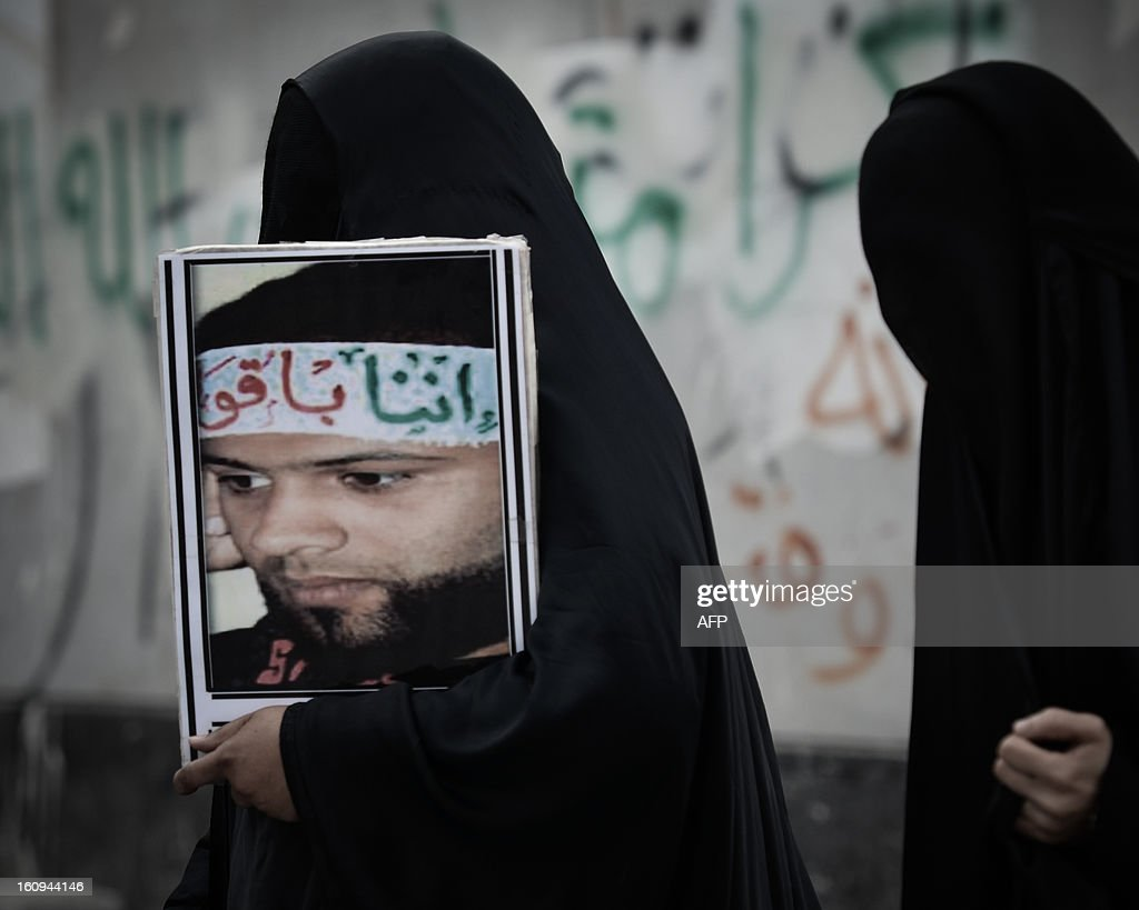 Bahraini woman carries a portrait of jailed activist Hassan Mohammed Hassan during an anti-government rally to demand reforms on February 7, 2013 in the village of Karannah, west of the Bahraini capital Manama. Bahrain's national dialogue resumes on February 10, 2013 amid mutual mistrust between the government and the opposition as the second anniversary of a Shiite-led uprising that shook the strategic Gulf kingdom nears.